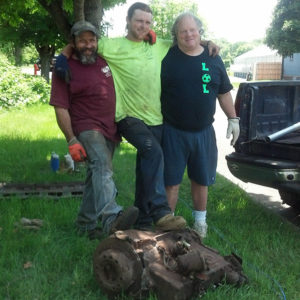SUCCESS!  Frank, Jim, And Paul Celebrate The Removal Of The 350-pound Engine Block. All Photos Of Car Removal By Beth Sullivan.